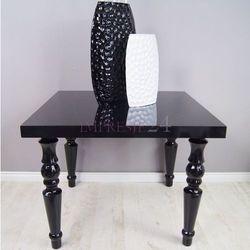 Czarny stolik, toczone nogi, wysoki połysk.